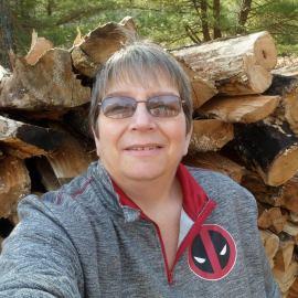 Me at woodpile.jpg